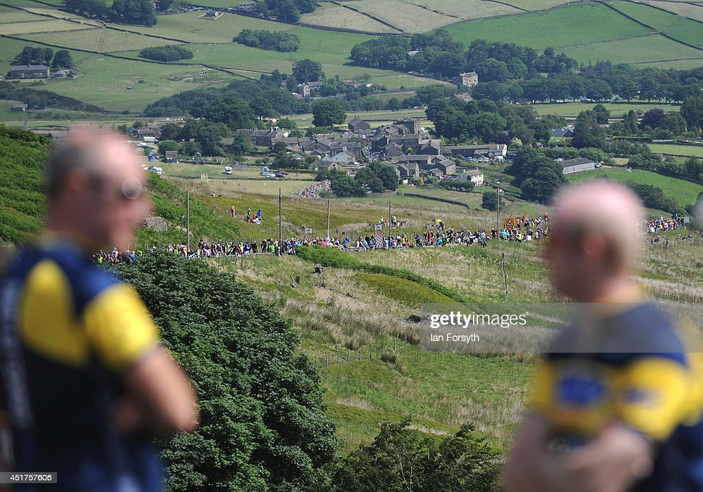 Spectators make their way up a hill called Holm Moss in Yorkshire as they get ready to watch Stage 2 of the Tour de France on July 6, 2014 in Holm Moss, United Kingdom. The world's greatest cycle race, the Tour de France started for the first time in its history in Yorkshire this weekend. The event has brought thousands of cycling fans to Yorkshire.