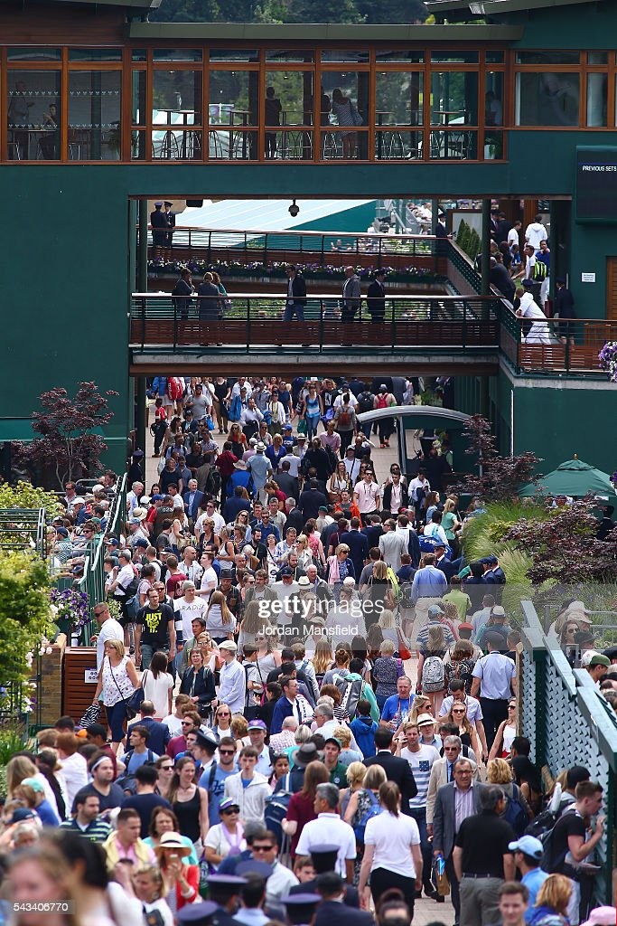 spectators make there way around the courts on day two of the Wimbledon Lawn Tennis Championships at the All England Lawn Tennis and Croquet Club on June 28, 2016 in London, England.