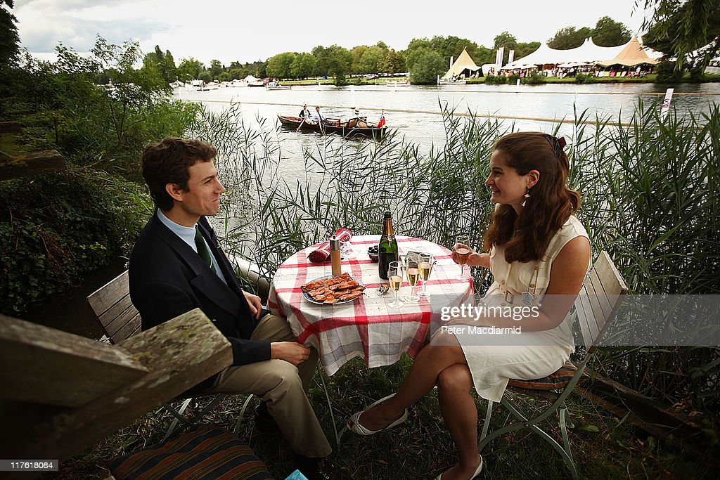 Spectators Mark Vivian and Elenor Turner Moss enjoy a Champagne and smoked salmon lunch on the river bank at the Henley Royal Regatta on June 29, 2011 in Henley-on-Thames, England. The 172-year-old rowing regatta begins today and takes place on The River Thames over five days.