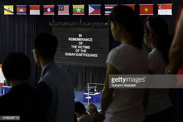 Spectators observe a minute silence in remembrance of the victims of the Sabah earthquake before the men's gymnastic individual allaround final at...