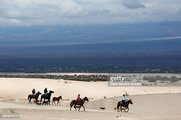 Spectators of fans arrive to watch the days action riding horses and being followed by their dogs on day 11 stage ten between Belen and La Rioja...