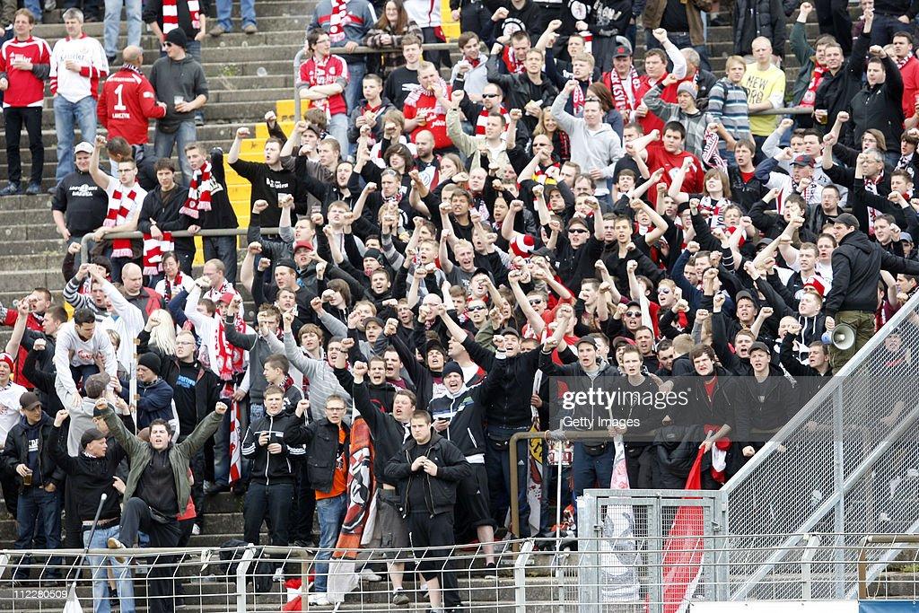 Spectators of Kassel are seen during the Regionalliga Sued match between SV Darmstadt 98 and KSV Hessen Kassel on April 16 2011 in Darmstadt Germany