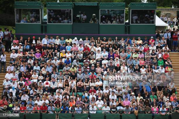 Spectators on Court 18 watch the Gentlemen's Singles first round match between Grigor Dimitrov of Bulgaria and Simone Bolelli of Italy on day two of...