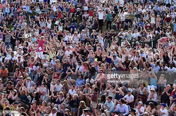 Spectators on 'Henman Hill' celebrate as Andy Murray of Great Britain beats Ivo Karlovic of Croatia during day eight of the Wimbledon Lawn Tennis...