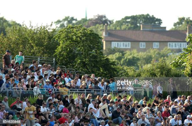 Spectators on Murray Mount observe Great Britain's Andy Murray's match against France's Richard Gasquet during the Wimbledon Championships 2008 at...