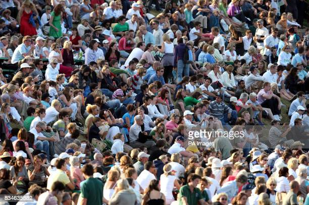 Spectators on Murray Mount observe Great Britain's Andy Murrays match against France's Richard Gasquet during the Wimbledon Championships 2008 at the...
