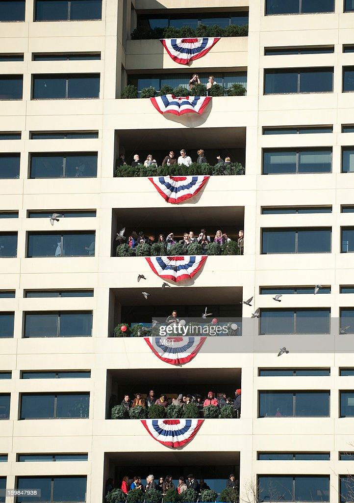 Spectators on Pennsylvania Avenue watch the inaugural parade on Monday, January 21, 2013 in Washington, D.C.