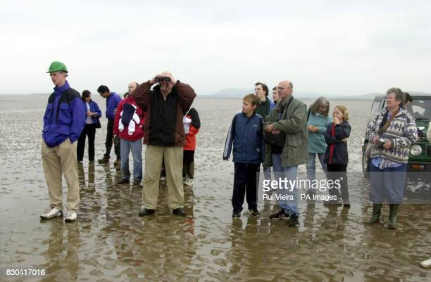 Spectators on the way to the launch site of space fanatic Steve Bennett's rocket Starchaser Discovery on Floock sands in Morecambe Bay on the border...