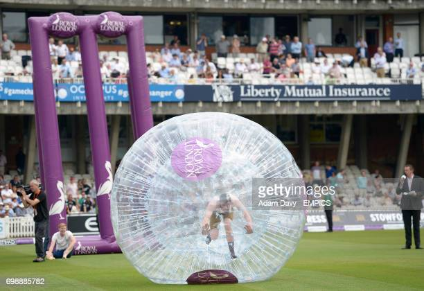 Spectators participate in Zorbing activities during an interval