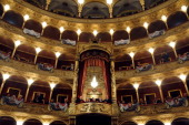 Spectators peer down from the galleries at Rome's Opera House prior to Director Riccardo Muti's production of the Verdi opera The Nabucco to mark the...