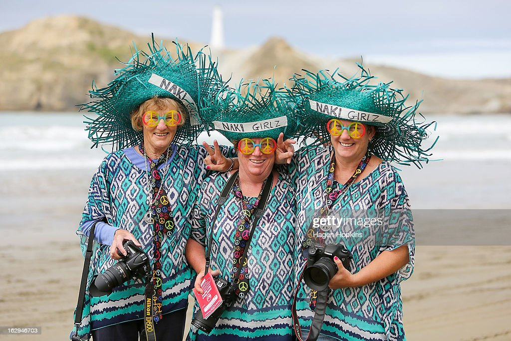 Spectators pose during the Castlepoint Beach Races at Castlepoint Beach on March 2, 2013 in Masterton, New Zealand.
