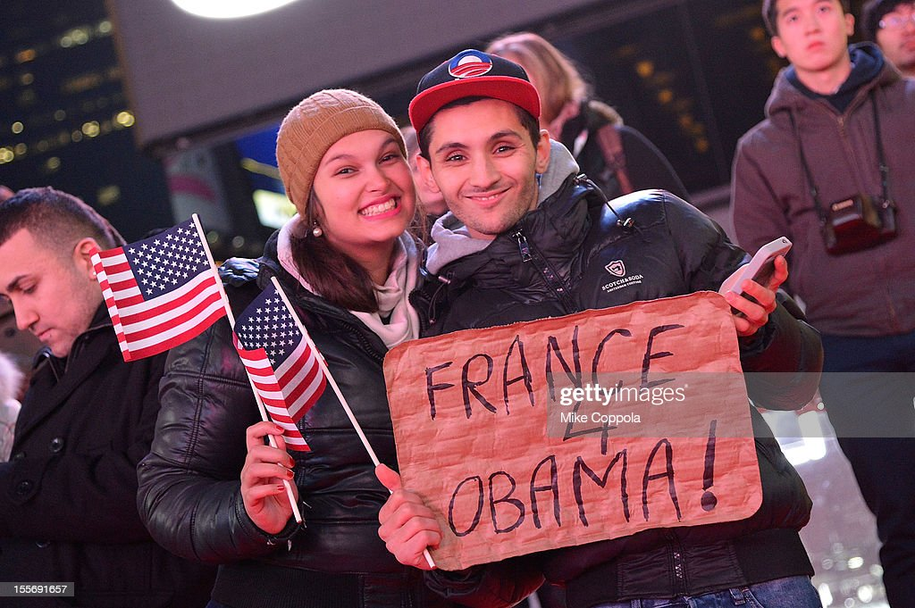 Spectators pose for a picture as they watch the results of the 2012 Presidential election night in Times Square on November 6, 2012 in New York City.