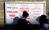 Spectators queue as they wait for the gates to be opened ahead of day five of the 1st npower test match between England and India at Lord's Cricket...