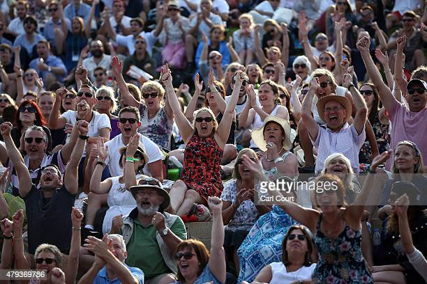 Spectators react as they watch a large screen television showing the Ladies Singles Third Round match between Serena Williams of the United States...