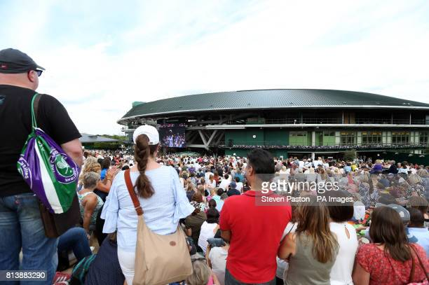 Spectators react as they watch Johanna Konta's semi final match against Venus Williams from Murray Mound on day ten of the Wimbledon Championships at...