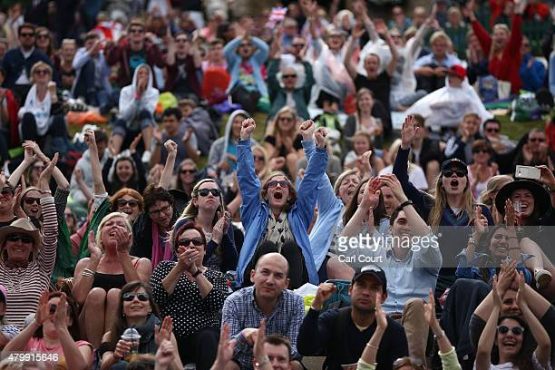 Spectators react at match point on Murray Mound as Andy Murray of Great Britain beats Vasek Pospisil of Canada in their Gentlemen's Singles Quarter...