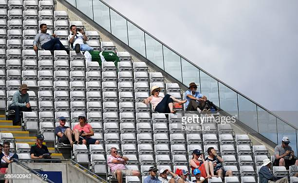 Spectators relax in the stands during play on the fourth day of the third test cricket match between England and Pakistan at Edgbaston in Birmingham...