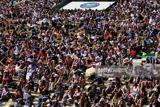 Spectators relax in the sun on Murray Mound on day eleven of the Wimbledon Lawn Tennis Championships at the All England Lawn Tennis and Croquet Club...
