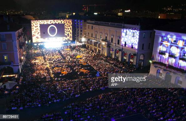 Spectators seated infront of the giant screen at the Piazza Grande during the 62nd Locarno international film festival on late August 9 2009 in...