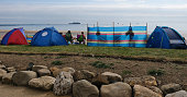 Spectators set up tent and windbreaks as they attend the 28th Sunderland International Air show on July 23 2016 in Sunderland England Held over three...