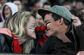 Spectators share a hongi wearing red noses to raise awareness for the Cure Kids charity during during The Rugby Championship match between the New...