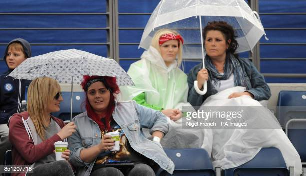 Spectators shelter from the rain during the break in play between Alison Riske and Daniela Hantuchova during the AEGON Classic at Edgbaston Priory...