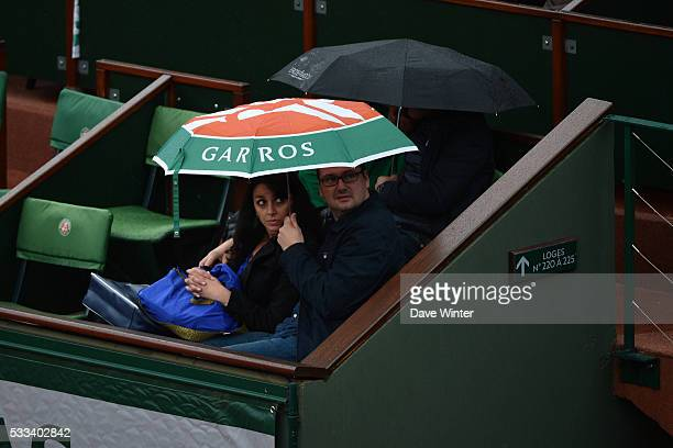 Spectators shelter from the rain during the French Open 2016 on May 22 2016 in Paris France