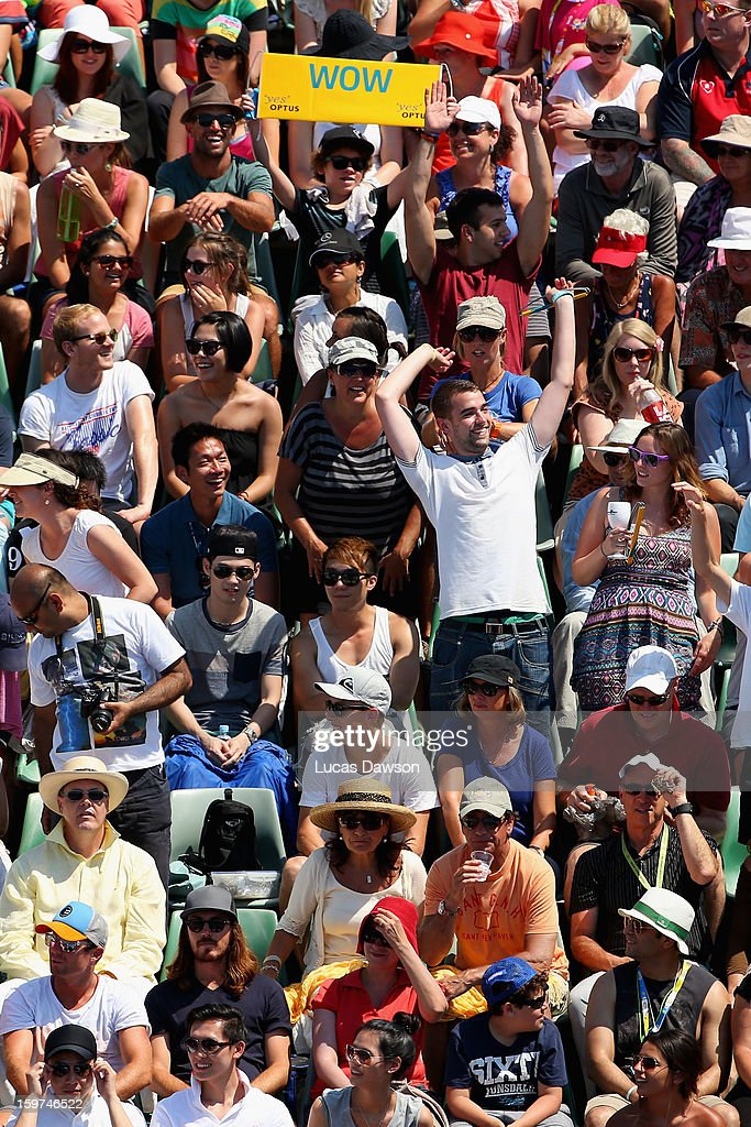 Spectators show their support in the third round doubles match between Sara Errani and Roberta Vinci of Italy and Su-Wei Hsieh of Chinese Taipei and Shuai Peng of China during day seven of the 2013 Australian Open at Melbourne Park on January 20, 2013 in Melbourne, Australia.