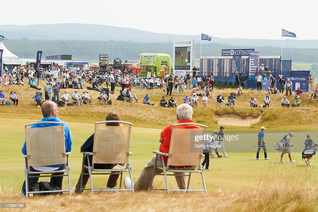 Spectators sit and watch the action during the first round of the Aberdeen Asset Management Scottish Open at Castle Stuart Golf Links on July 11, 2013 in Inverness, Scotland.