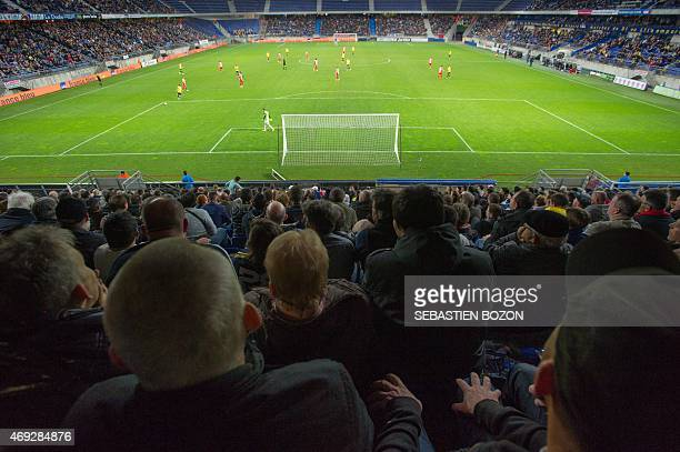 Spectators sit in the stands during the French L2 football match Sochaux vs Creteil on April 10 2015 at the Auguste Bonal stadium in Montbeliard...