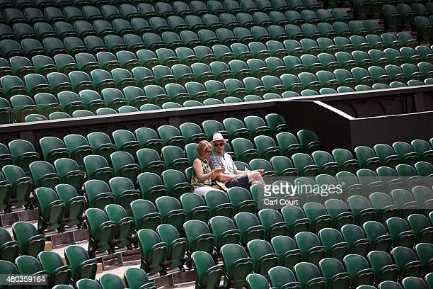 Spectators sit in their seats on Centre Court several hours ahead of the Ladies Singles Final between Serena Williams of the USA and Garbine Muguruza...