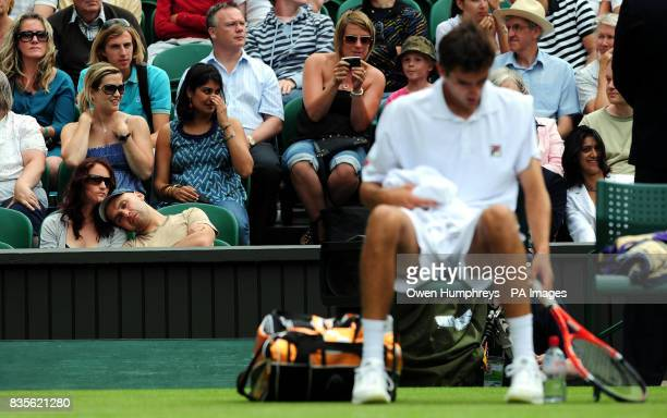Spectators sleep as USA's Sam Querrey plays Croatia's Marin Cilic during the 2009 Wimbledon Championships at the All England Lawn Tennis and Croquet...