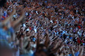 Spectators soak up the atmosphere during the Closing Ceremony on Day 16 of the London 2012 Olympic Games at Olympic Stadium on August 12 2012 in...