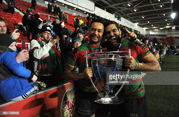 Spectators take photographs as captain Greg Inglis and John Sutton of South Sydney Rabbitohs of South Sydney Rabbitohs celebrate with the trophy...