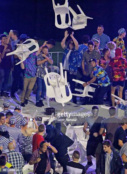 Spectators throw chairs and tables during the final between Simon The Wizard Whitlock and Mighty Michael van Gerwen during the Invitational Darts...