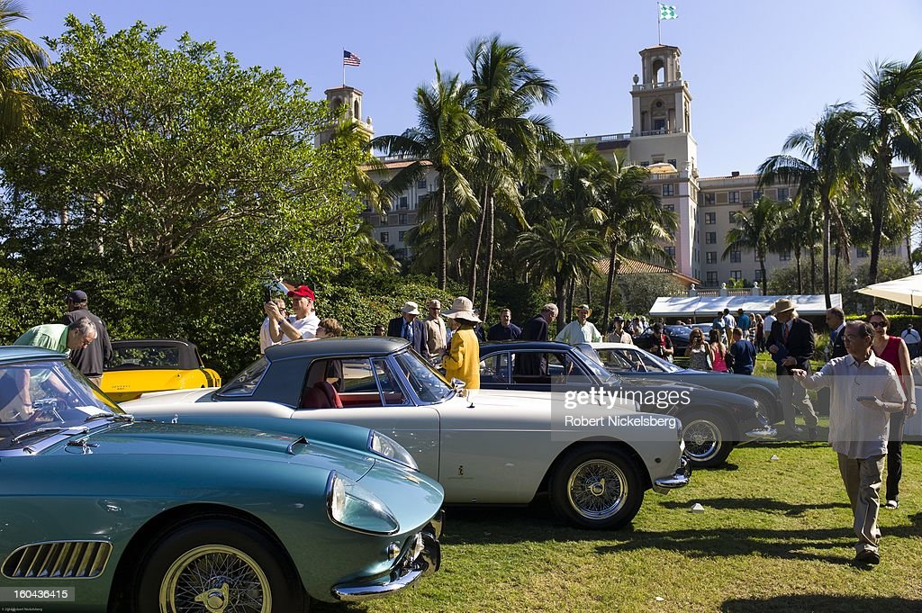 Spectators tour an antique Ferrari automobile competition at the annual Cavallino Auto Competition, January 26, 2013 held at The Breakers Hotel in Palm Beach, Florida.