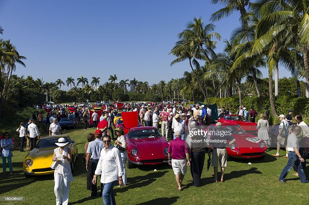 Spectators view a field of new and antique Ferrari automobiles at the annual Cavallino Auto Competition, January 26, 2013 held at The Breakers Hotel in Palm Beach, Florida.