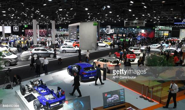Spectators visit the hall of German Volkswagen group including cars of VW Audi and Seat at the Frankfurt Auto Show IAA in Frankfurt am Main Germany...