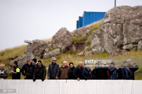 Spectators wach a Germany training session ahead of the FIFA 2014 World Cup Qualifier match between Faroe Islands and Germany on September 9 2013 in...