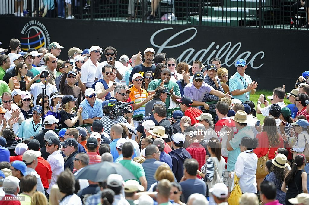 Spectators wait for Phil Mickelson at the first tee during the final round of the World Golf Championships-Cadillac Championship at TPC Blue Monster at Doral on March 10, 2013 in Doral, Florida.
