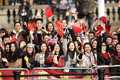 Spectators wait for Queen Elizabeth II and President of The People's Republic of China Mr Xi Jinping to pass along The Mall after the ceremonial...