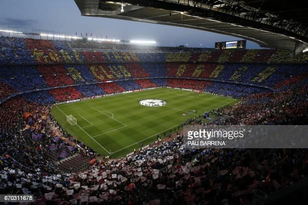 Spectators wait for the kick off before the UEFA Champions League quarterfinal second leg football match FC Barcelona vs Juventus at the Camp Nou...