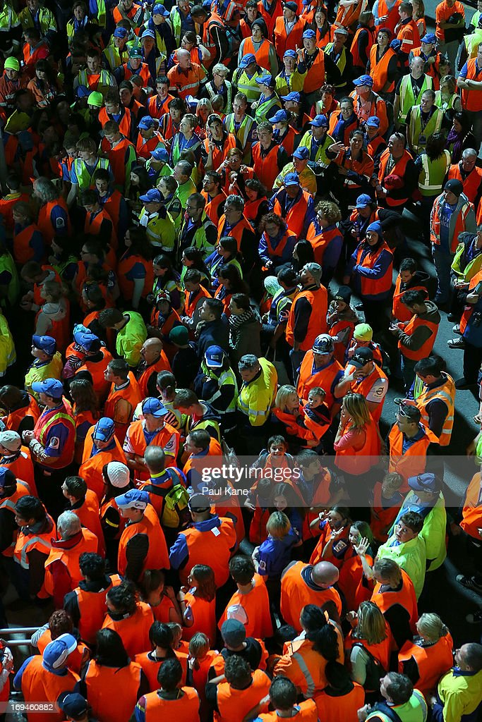 Spectators wait to enter the field in an attempt to break a world record for the most number of people wearing high visibility clothing in one place at the same time after the round 15 Super Rugby match between the Western Force and the Highlanders at nib Stadium on May 25, 2013 in Perth, Australia.