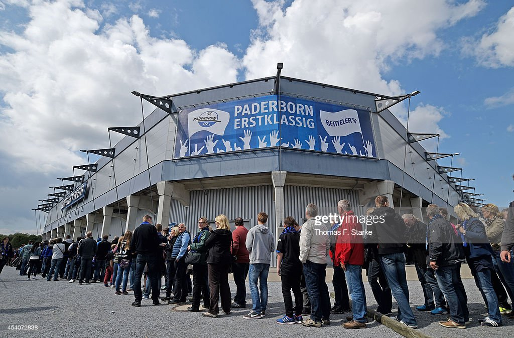 Spectators wait to enter the stadium prior to the Bundesliga match between SC Paderborn and FSV Mainz 05 at Benteler Arena on August 24 2014 in...