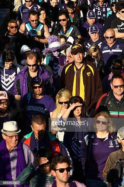 Spectators walk to the stadium for the AFL 1st Semi Final match between the Fremantle Dockers and the Port Adelaide Power at Patersons Stadium on...