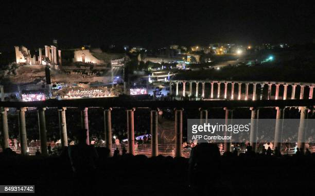 Spectators watch a concert by Italian tenor Andrea Bocelli at the archaeological site of Jerash some 50 kilometres north of the Jordanian capital on...