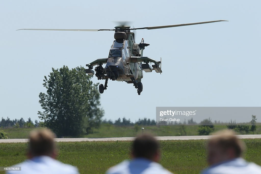 Spectators watch a Eurocopter Tiger EC665 military attack helicopter lift off at the ILA 2014 Berlin Air Show on May 21, 2014 in Schoenefeld, Germany. The ILA 2014 is open from may 20-25.