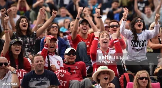 Spectators watch a giant screen showing the second set tiebreak in the men's singles final match between Serbia's Novak Djokovic and Switzerland's...