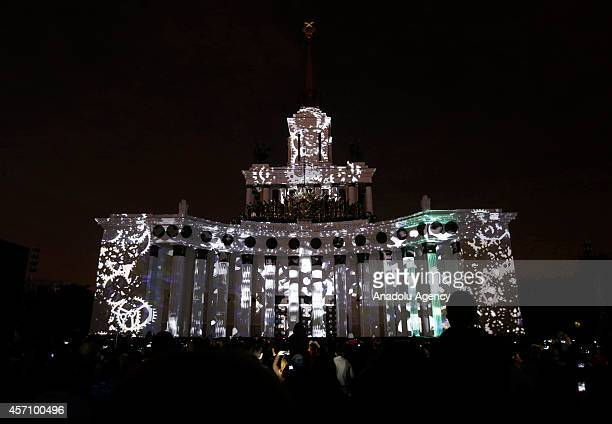 Spectators watch a light show that projected on the facade of the Bolshoi Theatre during the Circle of Light International Festival in Moscow Russia...