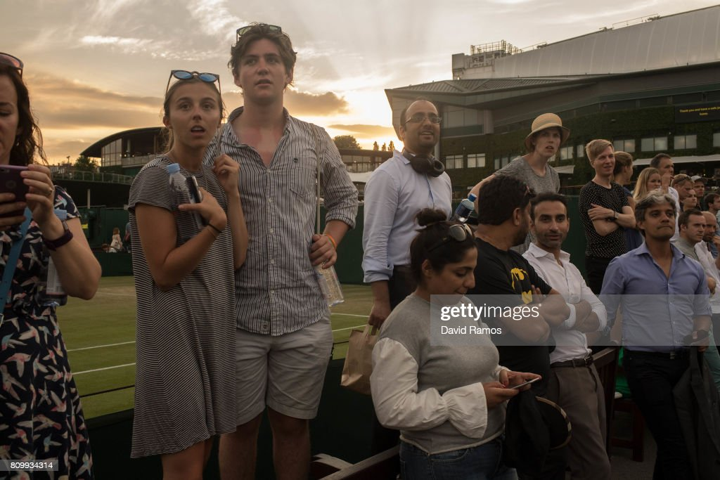 Spectators watcH a match in the outside courts on day four of the Wimbledon Lawn Tennis Championships at the All England Lawn Tennis and Croquet Club on July 6, 2017 in London, England.